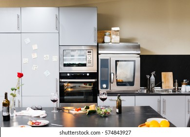 Empty kitchen with home appliances and food