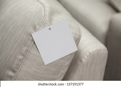 empty label attached to the sofa