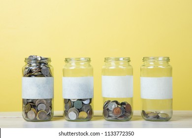 An empty label of glass jars with coins. saving concept