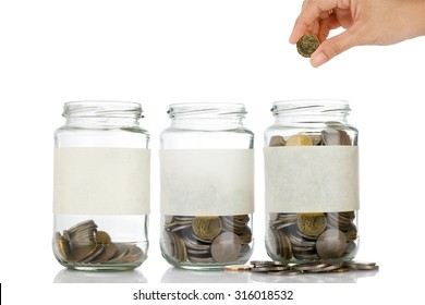 An empty label of glass jars with coins like diagram with woman right hand want to put coin on it isolated on white background - savings, financial, loan, retirement, and home concept