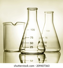 empty laboratory glassware with reflection