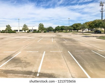 Empty large office parking lots at business park in America. Cloud blue sky background.
