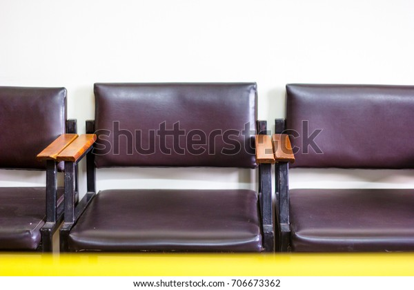 Fabulous Empty Leather Chairs Wooden Armrest Alignment Stock Photo Gmtry Best Dining Table And Chair Ideas Images Gmtryco