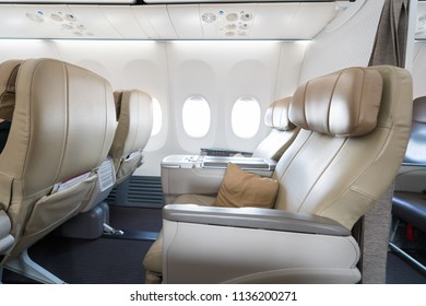 Empty leather seats in row atBusiness class reclined seats of airplane.