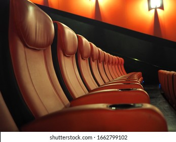 Empty Leather Seats In Row At Movie Theater - great entertainment fun background image