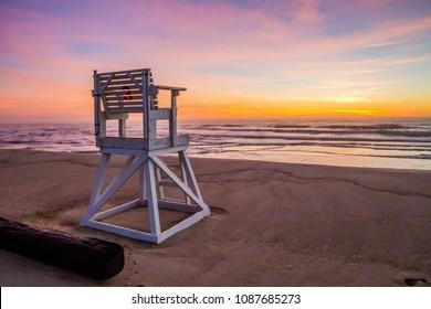 Empty lifeguard chair at sunrise on Coast Guard Beach, Cape Cod