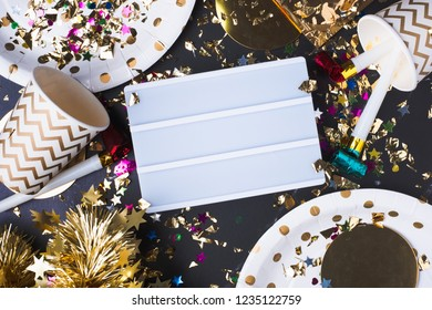 Empty light box with party cup,party blower,tinsel,confetti.Fun Celebrate New year holiday or birthday and anniversary party time table top view.mock up for adding text or design
