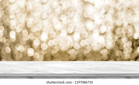 Empty light grey marble glossy table top with blur sparkling gold bokeh abstract background,panoramic banner for display or montage of product,Holiday seasonal concept backdrop