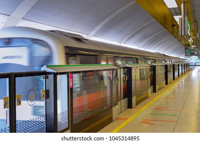 Empty light rail transit station in Singapore. Metro train motion blur