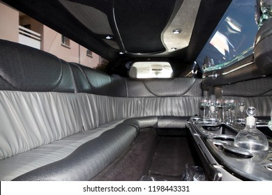 empty limo interior with drink and glasses