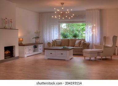 Empty living room in soft colors, with atmospheric lights.