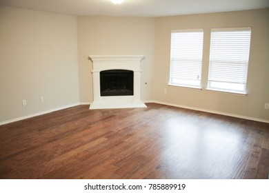 Empty Living Room with Wood Flooring and Fireplace