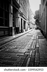 Empty London side street with neo noir black and white poster effect