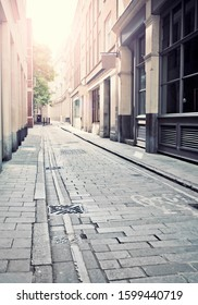 Empty London side street with sun flare, focus mid image