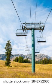empty long chair lift at a ski resort in the Rocky Mountains of Montana in autumn