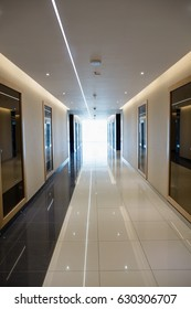 Empty long corridor in the modern office building