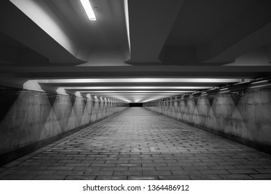 empty long lighted underpass by night, the image transition in perspective