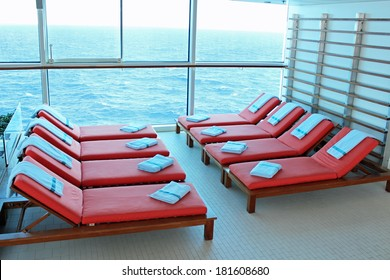 Empty lounge chairs in the solarium of a cruise ship