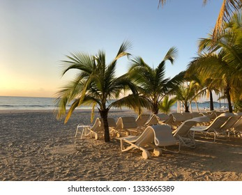 Empty loungers waiting for beach goers on sunrise