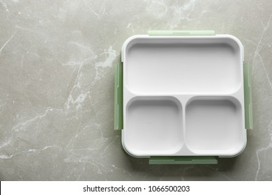 Empty lunch box on table, top view