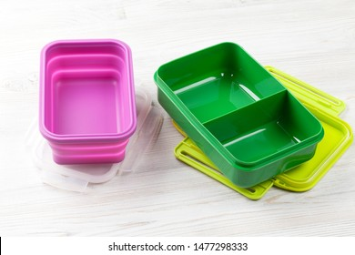 Empty lunch boxes on wooden table