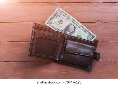 Empty male wallet with one dollar bill