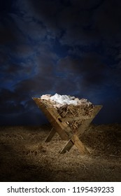 Empty manger with light coming down from the sky during night