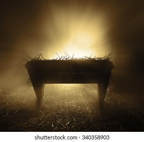 An empty manger at night with bright lights.