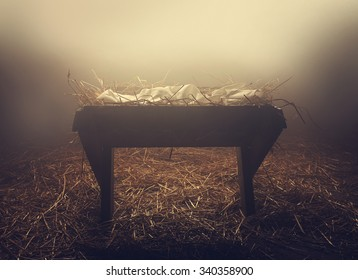 An empty manger at night under foggy conditions