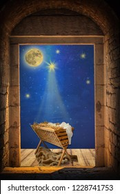 Empty manger under night sky and moon