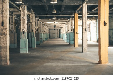 Empty manufactory. Laconic colorful photo of an old forgotten manufactory without people in it