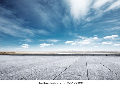 empty marble floor and beautiful snow mountains in blue sky