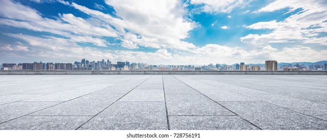 empty marble floor and cityscape of chongqing in blue cloud sky