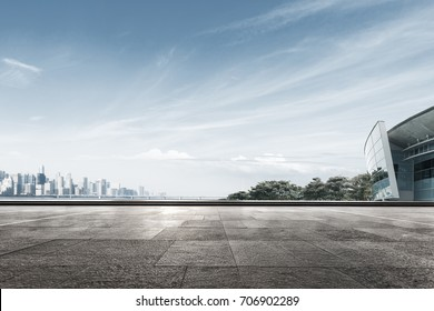 empty marble floor and cityscape of hangzhou in blue sky