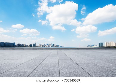 empty marble floor and cityscape of hangzhou in blue cloud sky