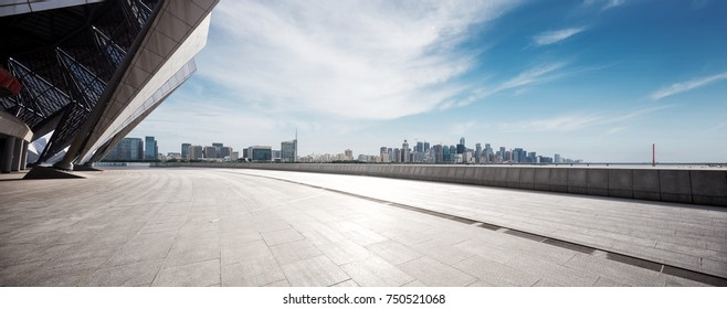 empty marble floor and cityscape of hangzhou qianjiang new city in blue cloud sky