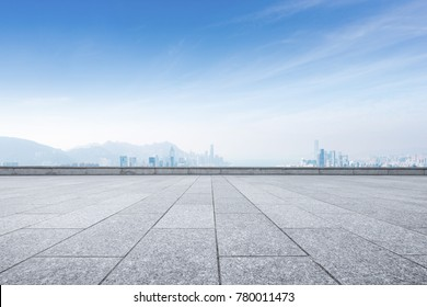 empty marble floor and cityscape of hong kong in blue cloud sky