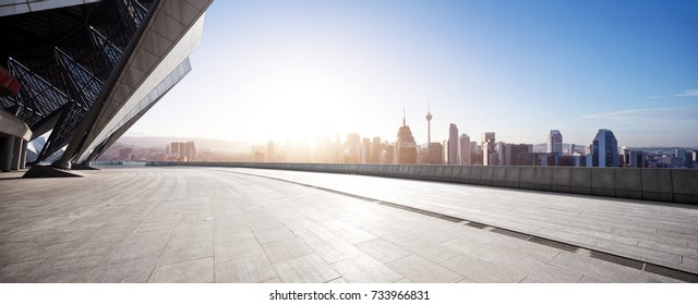 empty marble floor and cityscape of kuala lumpur with sunbeam
