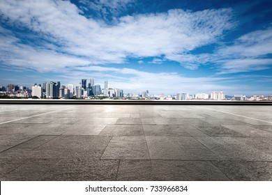 empty marble floor and cityscape of kuala lumpur in cloud sky