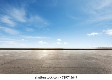 empty marble floor and snow mountains in blue cloud sky