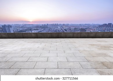 empty marble square of a modern city with skyscrapers