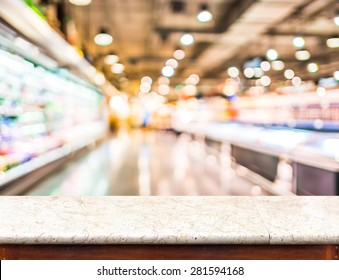 Empty marble table top and blurred supermarket bokeh light in background, Mock up for display of product