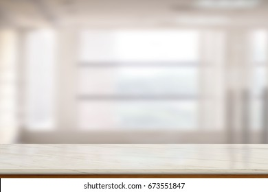 Empty Marble table top or marble counter in blurred empty office bacground. For product display montage.