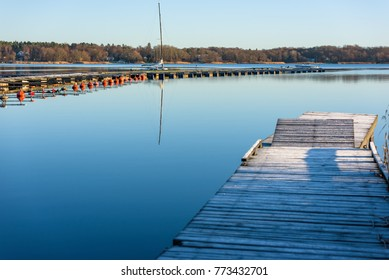 Empty marina and frost covered wooden pier in coastal landscape. Location Nattraby, Karlskrona, Sweden.