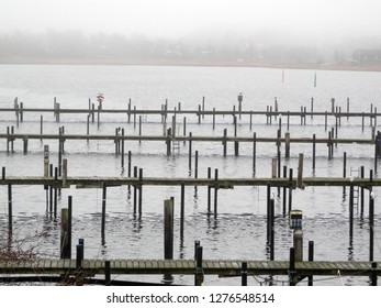 Empty marina on cold foggy winters day in southern denmark