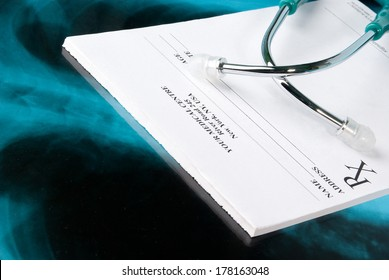 Empty medical prescription on Xray photo of lungs with stethoscope