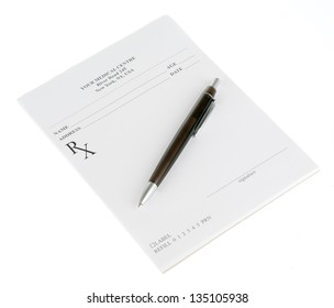 Empty medical prescription with a pen isolated on white background