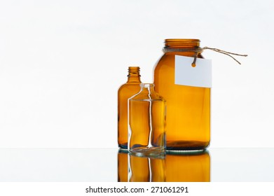 Empty medicine bottles on the light background