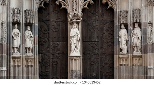 empty medieval european architecture background with antique temple doors and blacksmith forge, stone sculpture, texture and pattern decoration, nobody