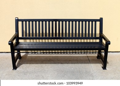 Empty metal bench in sunshine